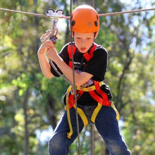 Load image into Gallery viewer, Boy with orange helmet experiencing high ropes course