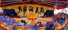 Load image into Gallery viewer, Children and families experiencing a ride, the Tango  at Luna-Park-Sydney