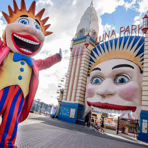Sydney Luna Park smiling face with a character at the front