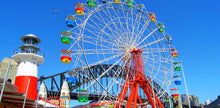 Load image into Gallery viewer, Ferris wheel in front of Sydney Harbour bridge at Luna Park