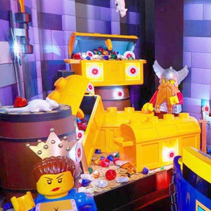 legoland ride showing 4 yellow chests with jewels, Viking and lego lady