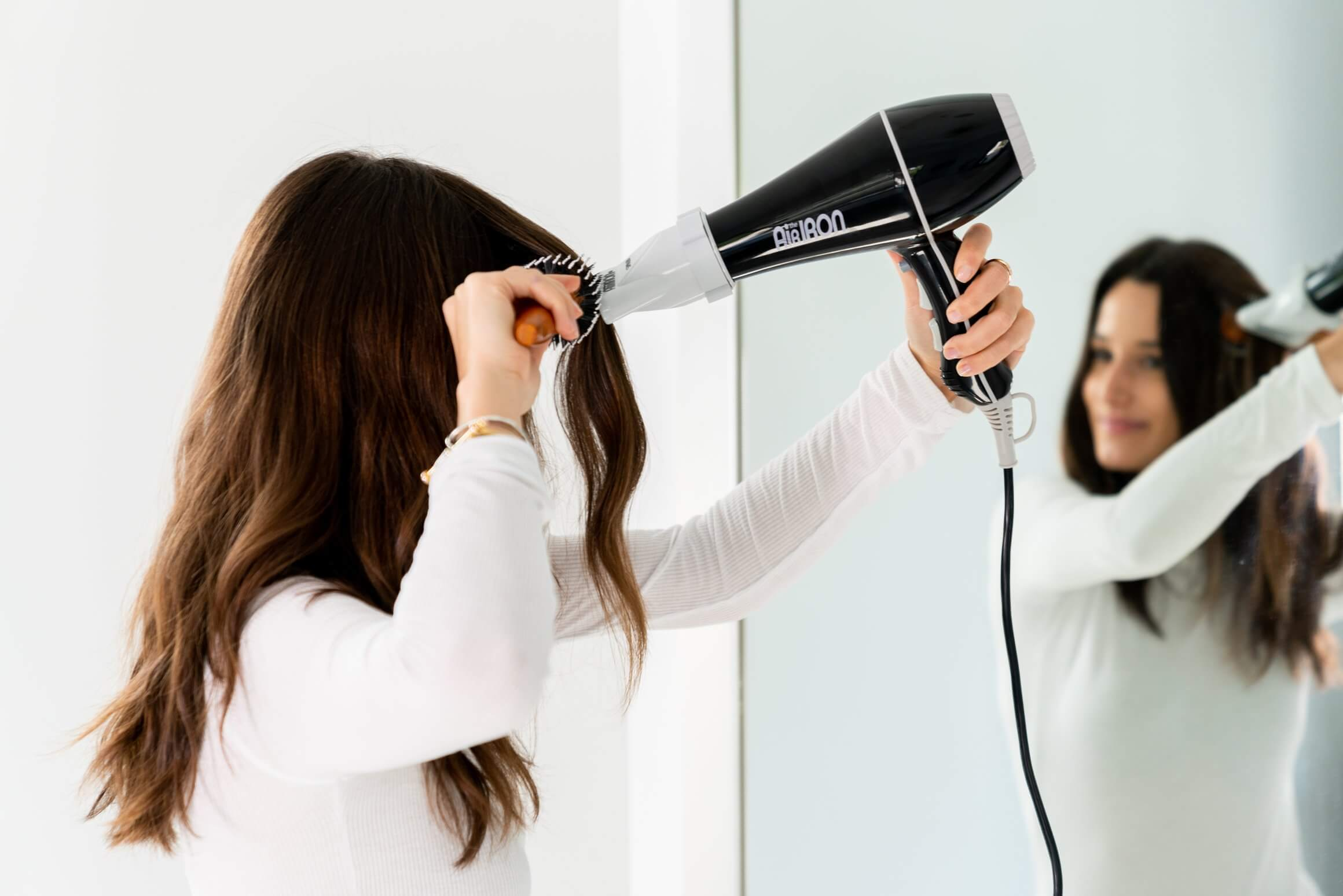 Hair dryer and straightener in one