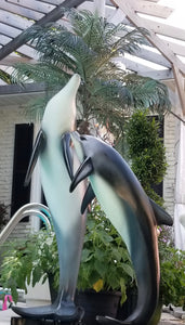 dolphin statue pair tropical pose