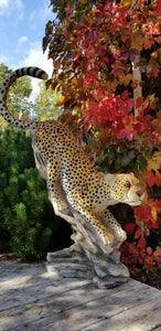 pouncing cheetah statue in side pose