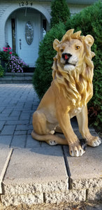 sitting lion statue on front porch