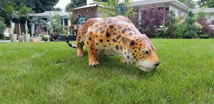 jaguar statue outside on the grass