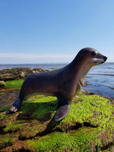 Load image into Gallery viewer, baby seal statue on the beach