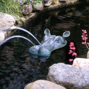 Hippo head garden statue spraying