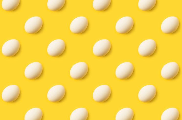 Yellow background with eggs that look like poka do