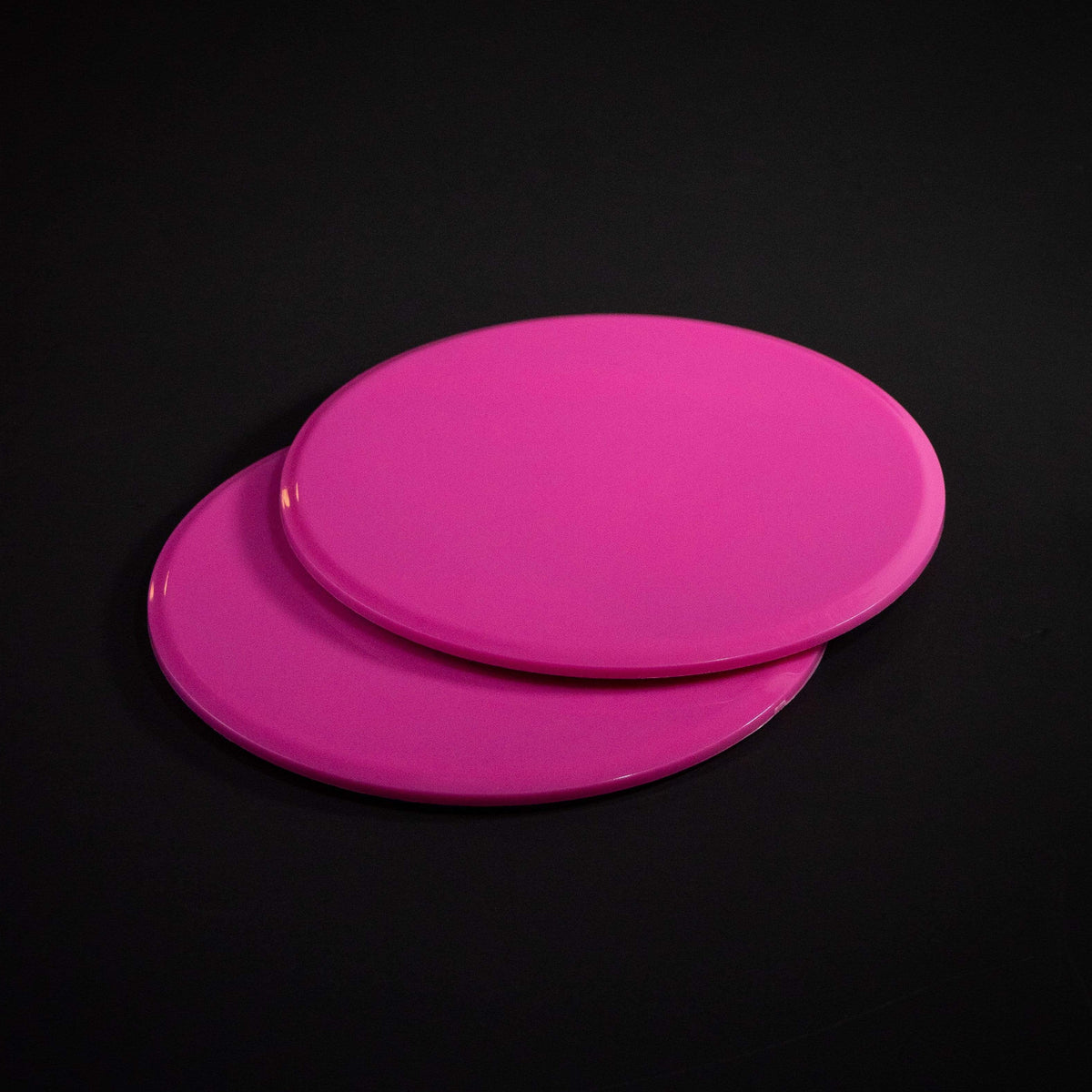Pink Core Sliding Discs on black background