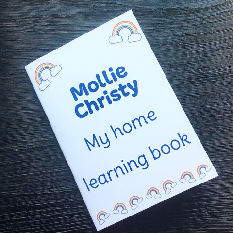 Mollie Christy personalised home learning exercise book, cover printed on brilliant white card with 2 rainbows at the top of the book and 7 rainbows across the bottom