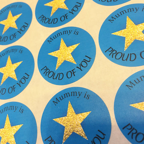 Blue circular sticker with a gold star saying Mummy is proud of you