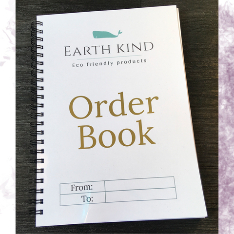 Earth Kind Eco friendly products white with green company logo A5 wire bound order book