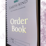 Earth Kind Eco friendly products white with green company logo A5 wire bound order book with foiling details on the cover