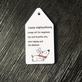White and black care instructions small luggage style swing tag with a picture of a dog with a red collar