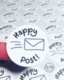 Close up of Happy Post black and white circular click and go sticker