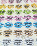Sheet of glitter chevron thank you for your order stickers in pink, gold, green, purple, blue, bronze, silver or mixed colours with black writing
