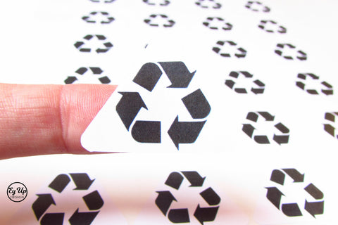 Recycle icon triangular stickers. Made from recycled paper.