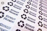 Sheet of Black and White recycled packaging click and go stickers with recycled icon made from recycled paper