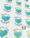 Sheet of Plastic Free Packaging black and white with green and blue earth design heart click and go sticker made from recycled paper