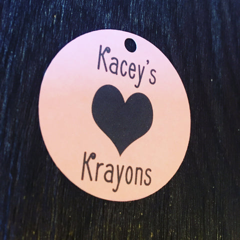 White and black Kacey's Krayons small round swing tag with black love heart design and 5mm round hole