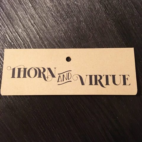 Thorn and Virtue jumbo tab topper on kraft card with 9mm round hole