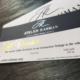 Atelier Rahman bespoke tailoring foiled gift voucher  printed on supersmooth white card on a dark blue background including gift voucher information and website address