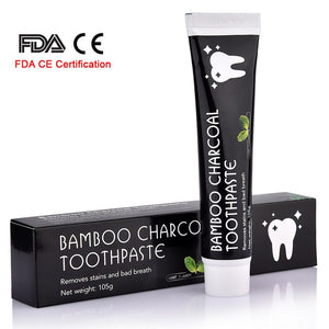 Teeth whitening with natural bamboo toothpaste activated by charcoal