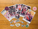 flat lay of massive science products including sticker pack and tarot postcards