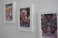 Image of 3 framed science tarot post cards. From left to right, Death, Magician, and Wheel of Fortune