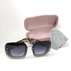 MIU MIU Reveal SMU 01R DHE-0A7 Sunglasses Transparent Gray Glitter