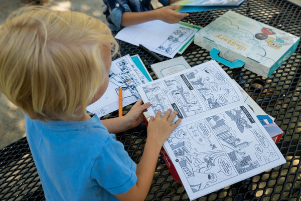 Children reading the My Comic Book Kit guide