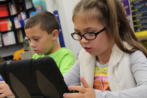 Kids using learning materials
