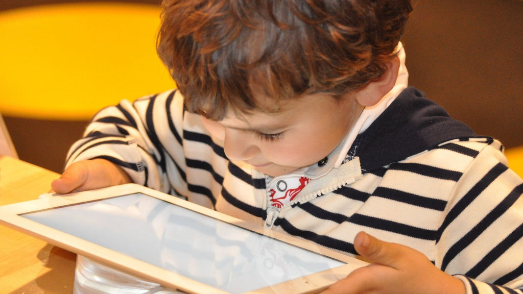 Child looking at a tablet