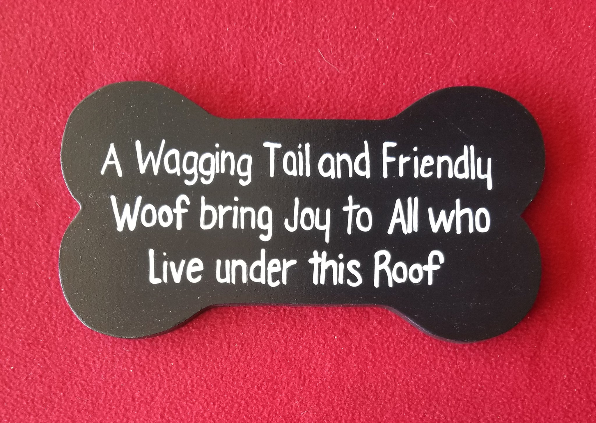 A wagging tail and friendly woof bring joy to all who live under this roof.