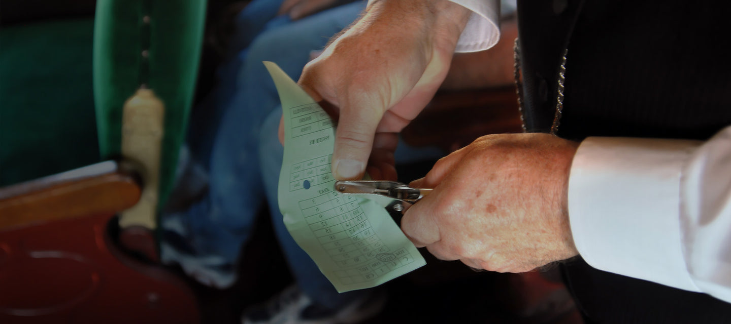 Train conductor punching a ticket with a hole punch