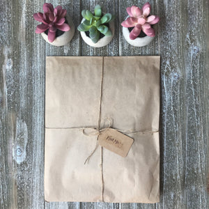 Picture of a package wrapped up with brown paper and string representing the adventure box