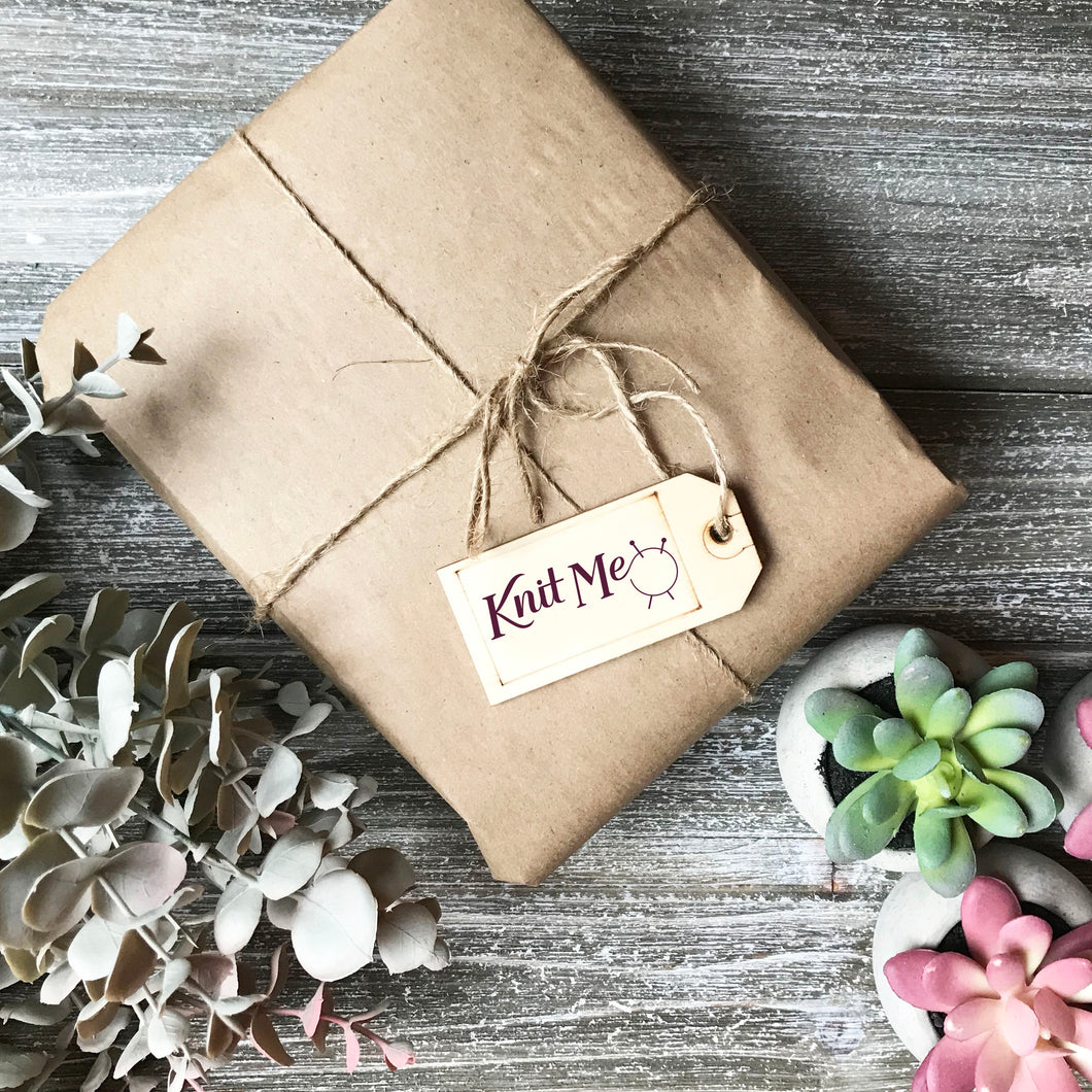 Picture of a package wrapped up with brown paper and string representing the Wonderland subscription box
