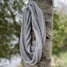 Load image into Gallery viewer, Sample of the knitted infinity scarf in grey