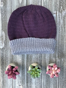 Knitted Sample of toque in purple and grey. Shown without pompom