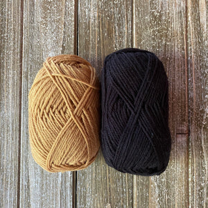 Mustard and black yarn