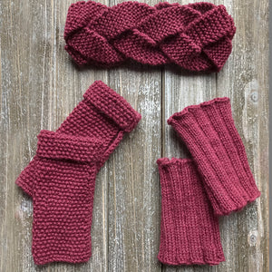 Knitted sample of the headband, fingerless gloves and bootcuffs in wine colour