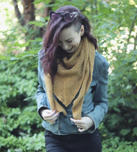 Load image into Gallery viewer, Kelsi modelling the extra cozy All Weather Wrap in the goldenrod colour
