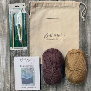 Beginner Cowl kit contents: mustard and brown yarn, pattern, knitting needles, wool needle, work in progress bag