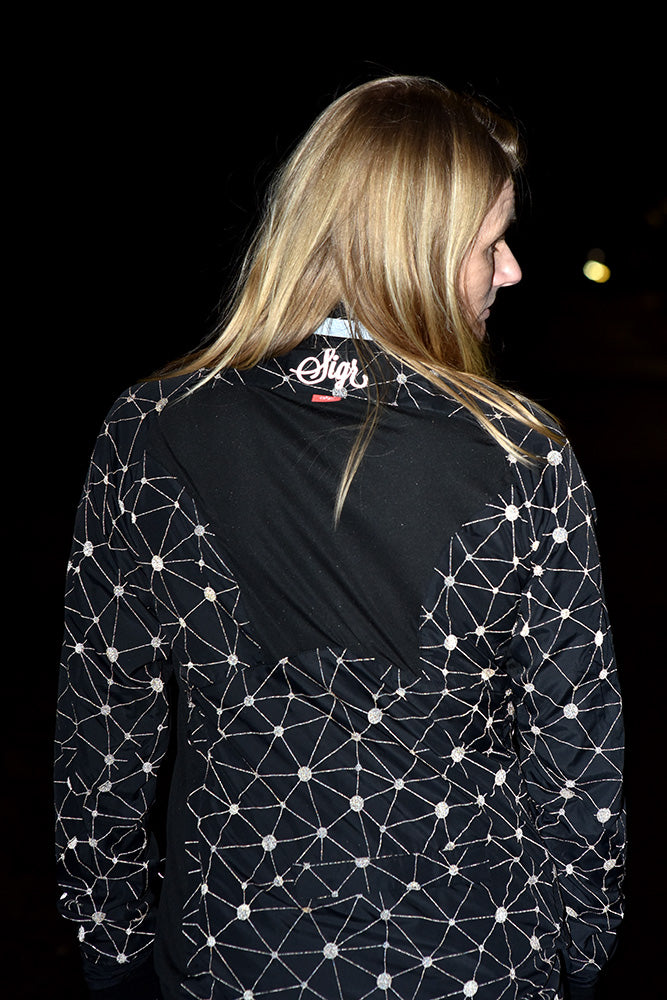 Sigr 'Norrsken' Reflective Cycling Pack Jacket for Women - Reflecting!