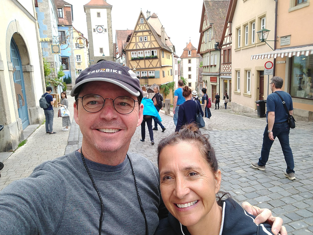 Photo of the author, Maria, and her husband Jim in Rothenburg ob der Tauber, a Medieval village in Bavaria