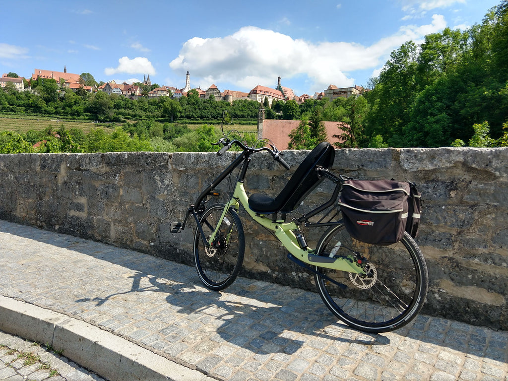 Photo of Cruzbike Q45 adventure touring recumbent bike with Bavarian village in the background on a beautiful day