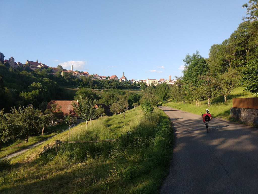Photo of Maria cycling along a quiet route in the Bavarian countryside