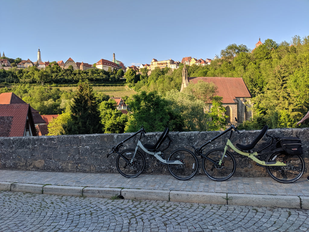 Photo of Jim and Maria's Cruzbike Q45 touring recumbent bikes on an old stone bridge overlooking the city
