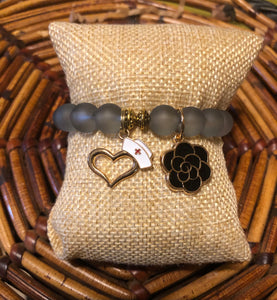 Nurse Frosted Black Flower Charmed Bracelet